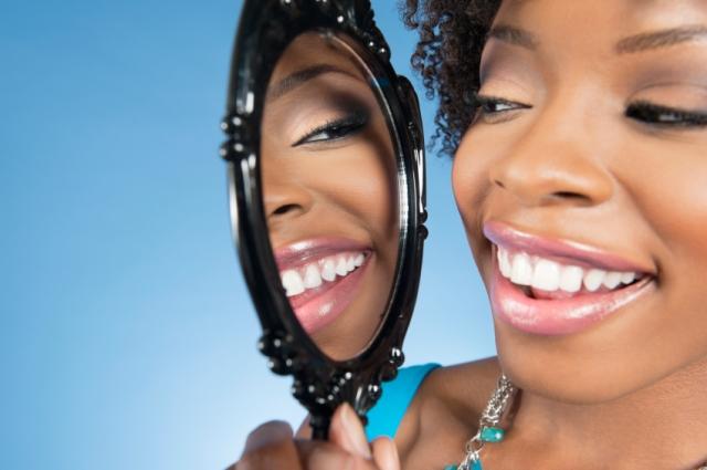 smiling at reflection