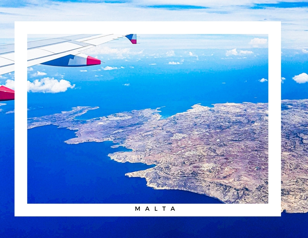 Aeroplane in flight, hovering above the Maltese Islands.
