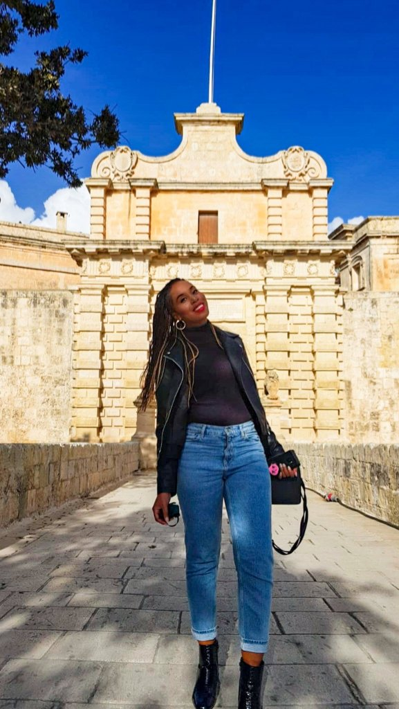 Girl in Malta standing outside Mdina walled city