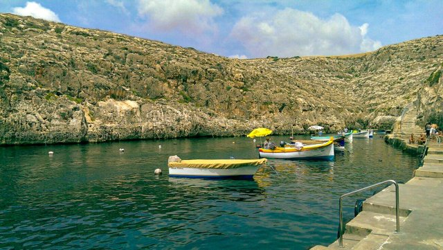 Zurrieq Boat, Malta pier, with several colourful tour boats are moored